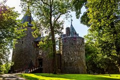 Castell Coch, Red Castle, Tongwynlais, South Wales. United Kingdom. Sunset over green lawn stock images