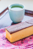 Castella - traditional Japanese sponge cake and hot tea. Castella - traditional Japanese sponge cake and hot tea Royalty Free Stock Photography