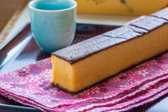 Castella - traditional Japanese sponge cake and hot tea. Castella - traditional Japanese sponge cake and hot tea Stock Photos