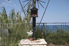 Iron christian cross. Castellammare del Golfo, Italy - September 04, 2018 : Iron christian cross in Castellammare royalty free stock photography