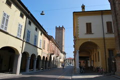 Castelleone village. With arcade and medieval tower in background, Cremona, Lombardy, Italy Stock Image
