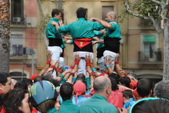 Castellers. A castell is a human tower built traditionally in festivals at many locations within Catalonia Stock Photos