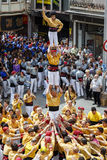Castellers in fira arrop Badalona. BADALONA, SPAIN- MAY 18, 2014: Some unidentified people called Castellers do a Castell or Human Tower, typical tradition in Stock Photos
