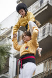 Castellers, girls and drop-tower Stock Image