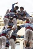 Castellers, muchachas y gota-torre imagen de archivo