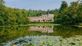 Castello del Catajo, a Venetian patrician house, and its reflectiton in the pond of its garden, near Padua, Italy stock image