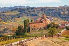 Castello della Volta. Autumnal vineyards and Castello della Volta in Piedmont, Northern Italy Royalty Free Stock Image