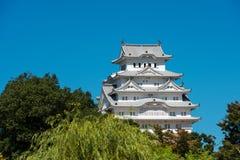 Castello di Himeji nel Giappone contro un chiaro cielo blu Fotografie Stock