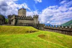 Castello di Montebello, Bellinzona, Switzerland. Medieval stone castel Castello di Montebello with defensive walls and towers in swiss Alps mountains, Bellinzona Stock Photo