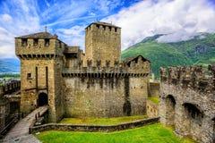 Castello di Montebello castle, Bellinzona, Switzerland. Medieval stone castel Castello di Montebello with defensive walls and towers in swiss Alps mountains Royalty Free Stock Images