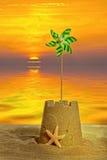 Castello di sabbia al tramonto Immagini Stock