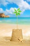 Castello di sabbia con la girandola Fotografie Stock