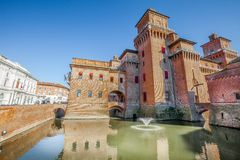 The Castello Estense in Ferrara in Italy. Moated medieval castle in the center of Ferrara, northern Italy. It consists of a large block with four corner towers royalty free stock photo