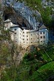 Castello medioevale, Predjama Fotografie Stock