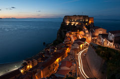 Castello Ruffo Scilla. Castello Ruffo Scilla (Reggio Calabria), taken with a long exposure after sunset. The important trails and lights of the village Stock Photography