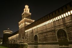 Wall of castello sforzesco in the night. The front side of Castello Sforzesco in Milan, Italy in the night illuminated by hundreds of light-bulbs stock photo