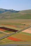 Castelluccio di Norcia/färgade panorama Arkivfoto