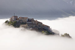 Castelluccio rising from the mist, Umbria, Italy Royalty Free Stock Photos