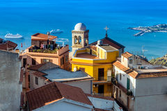 Castelmola bell tower. View from Castelmola, Sicily: the bell tower in the light of the morning sun and 2 cruise ships in the sea royalty free stock image