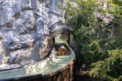 Castelnuovo del Garda, Italy - Agust 31 2016: Carousel. The carousel boat sails along river in the mountains. Gardaland Theme Amu. Carousel; Roller coaster; fun Royalty Free Stock Photos