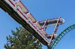 Castelnuovo del Garda, Italy - Agust 31 2016: Carousel. Roller coaster. Bottom view. Gardaland Theme Amusement Park in Castelnuov. Carousel; Roller coaster; fun Stock Photos