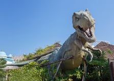Castelnuovo del Garda, Italy - Agust 31 2016: Dinosaur statue Yrannosaurus-rex Gardaland Theme Amusement Park in Castelnuovo stock images