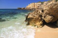 Castelo beach shore break. Summer day at Castelo beach, Albufeira, Algarve, Portugal royalty free stock images