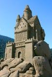 Castelo da areia com peixes Fotografia de Stock