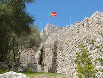 Castelo de Sesimbra in Portugal. With a flying flag Royalty Free Stock Photos