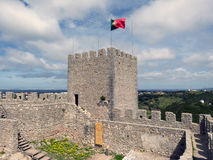 Castelo de Sesimbra in Portugal. With a flying flag Stock Photos