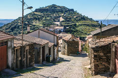 Castelo Melhor, Beira, Portugal. Castelo Melhor, a sleepy village on a rocky mountain peak with some olive trees and the ruins of an old castle royalty free stock photography