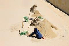 Castelos da areia na praia Imagens de Stock