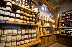 Castelrotto speck shop interior. The interior of a small speck shop of Italian Castelrotto (Kastelruth). Shelves with local food products and specialties Royalty Free Stock Photo