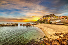 Castelsardo shoreline at sunset Royalty Free Stock Photography