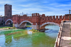 Castelvecchio bridge across the river. Royalty Free Stock Images
