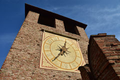 Castelvecchio Clock Tower, one of Verona city famous landmarks. Clock Tower from medieval Castelvecchio castle outer walls Stock Photography