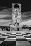 Castelvetro Modena clock tower checkerboard floor black and whit. E royalty free stock images