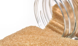 Caster sugar cane. Down by a glass jar royalty free stock photography