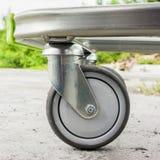 Caster wheel. Shopping basket caster photo closeup stock images