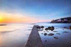 Castiglioncello bay concrete pier, rocks and sea on sunset. Tusc Royalty Free Stock Photo