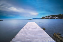 Castiglioncello bay wooden pier, rocks and sea on sunset. Tuscan Stock Photos