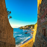 Castiglioncello sunset on cliff rock, beach and sea. Tuscany, It Royalty Free Stock Photography