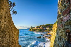 Castiglioncello sunset on cliff rock and sea. Tuscany, Italy. Royalty Free Stock Photos
