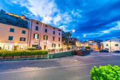 CASTIGLIONE DELLA PESCAIA, ITALY - JUNE 12, 2018: City center wi. Th tourists and homes on a summer night. This is a famous tourist destination in Tuscany Royalty Free Stock Photo