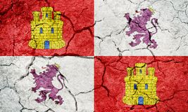 Castile and Leon flag. Autonomous community in north-western Spain, on dry earth ground texture background royalty free stock photo
