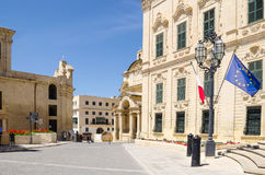 The Castille Place with Our Lady of Victories Chapel. Roman Catholic Church of Saint Catherine of Italy and  the Auberge de Castile et Leon with maltese and Stock Image