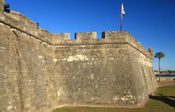 Castillio San Marcos fortress walls 2. Castillio San Marcos in St. Augustine, Florida with canon aimed at the town with Spanish flag Royalty Free Stock Images