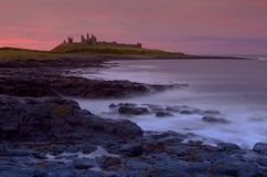 Castillo de Dunstanburgh fotos de archivo libres de regalías