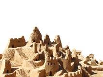 Castillo de la arena aislado en blanco Fotos de archivo