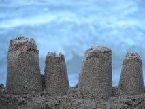 Castillo de la arena en una playa imágenes de archivo libres de regalías